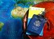 Suitcase, passport and map