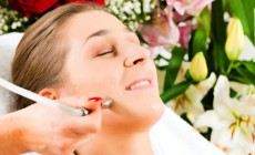 Woman in cosmetic salon receiving facial