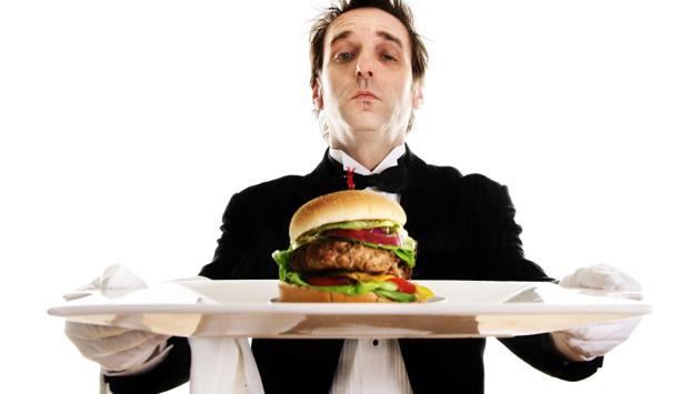Butler serving a burger