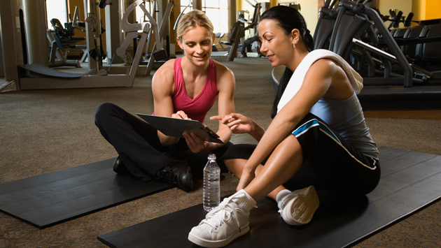 Woman with trainer at gym