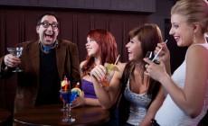 Man making women laugh at nightclub