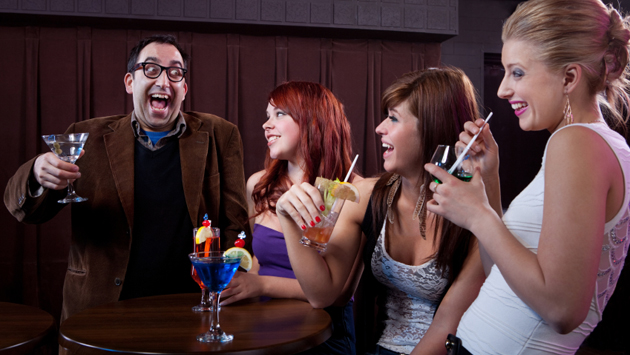 Man making women laugh at nightclub