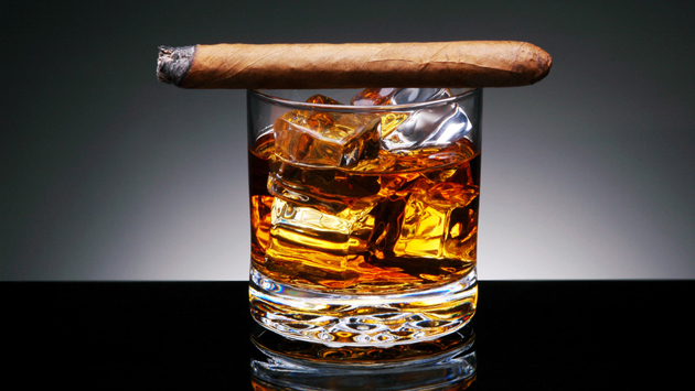 Cigar on top of alcoholic drink