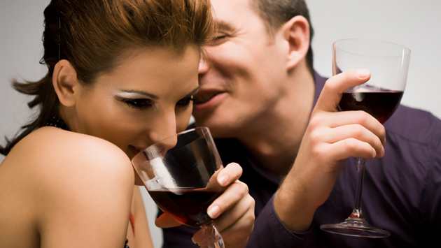 Couple flirting while drinking wine