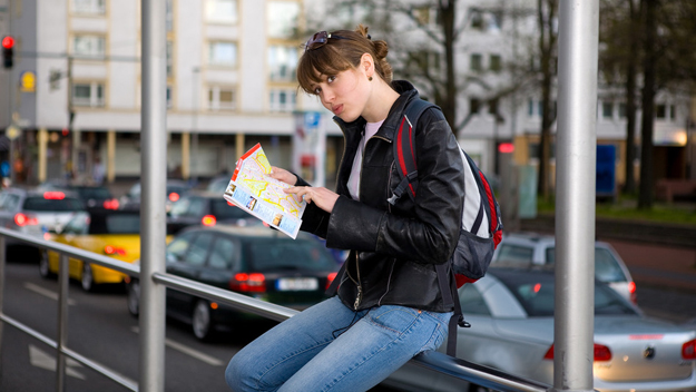 Young woman with city map in hands