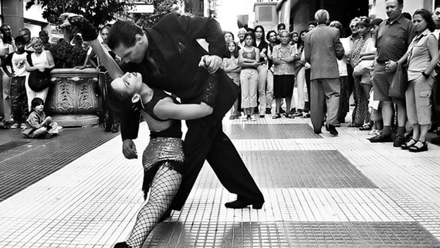 Couple dancing tango in streets