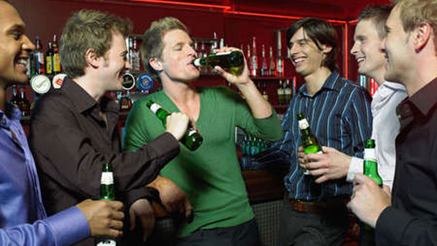Guys drinking at pub