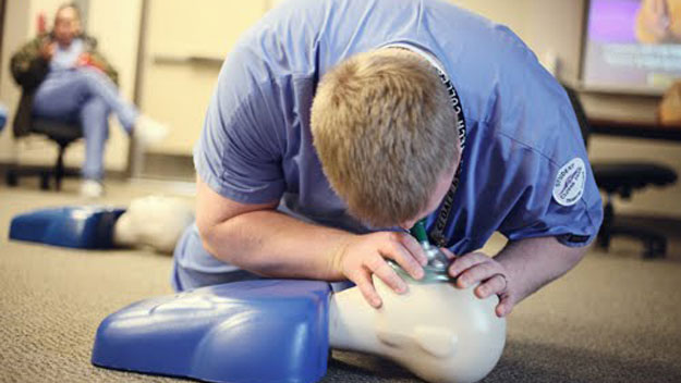 Learning CPR on dummy