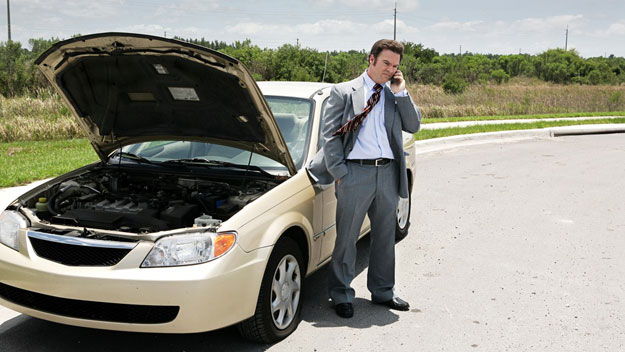 Man with car problems on side of road