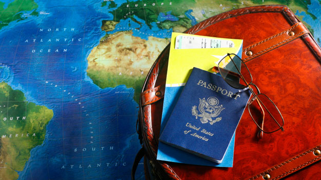 Map, suitcase and passport