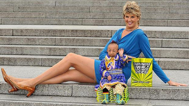 Shortest man next to woman with longest legs