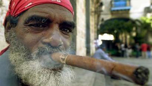 Smoking a big Cuban cigar in Old Havana