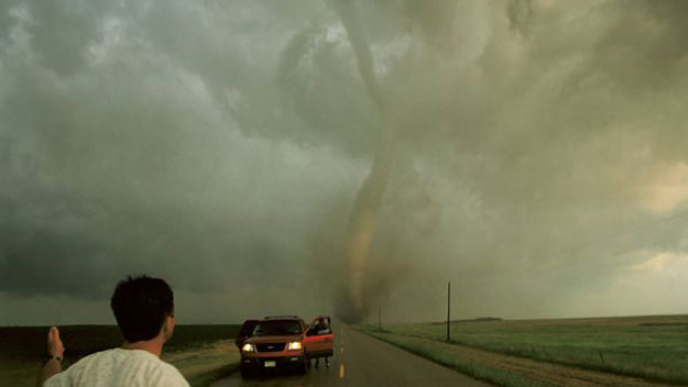 Storm chasers in front of tornado