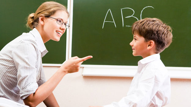 Teacher explaining grammar to student