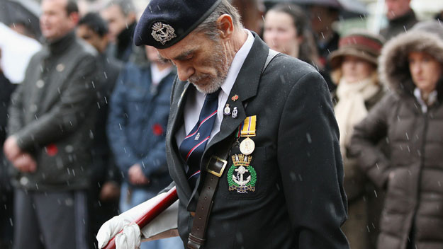 Veteran soldier observes silence