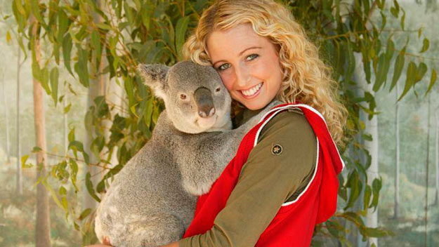 Woman cuddles with Koala