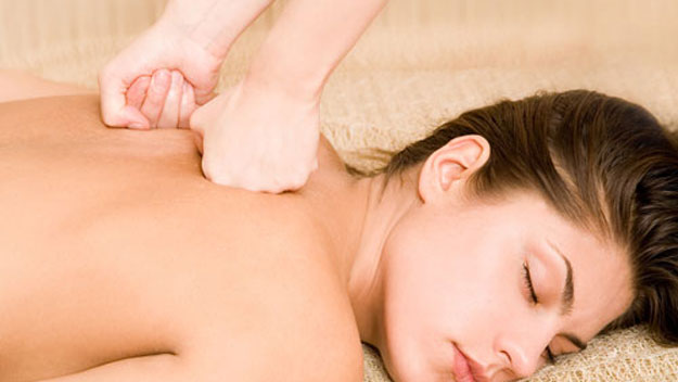 Woman getting a deep-tissue massage