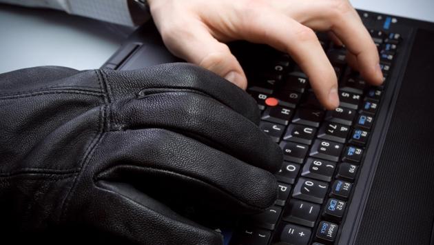 Hacker hands on laptop keyboard
