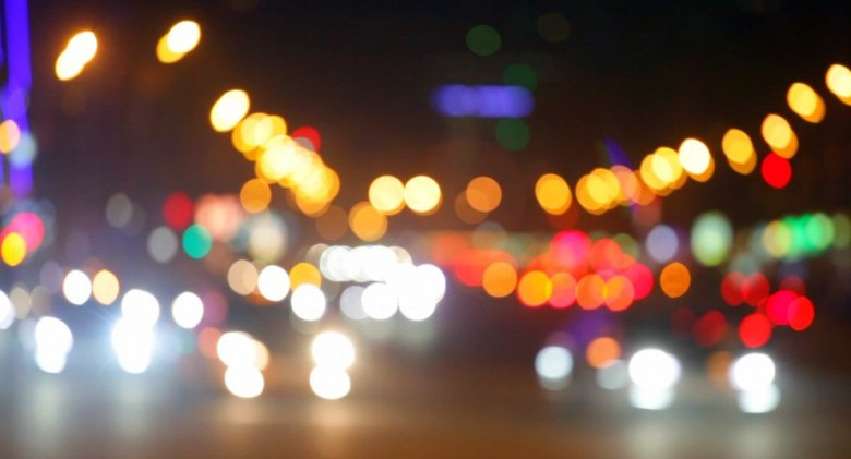 stock-footage-city-at-night-background-with-cars-out-of-focus-background-with-blurry-unfocused-city-lights